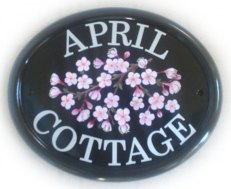 Cherry Blossom spray - painted by Gerry on a large classic oval sign base. Font is called Century Schoolbook